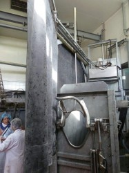 Rubber curtain blocks the view of further slaughter process at a Halal plant in France.